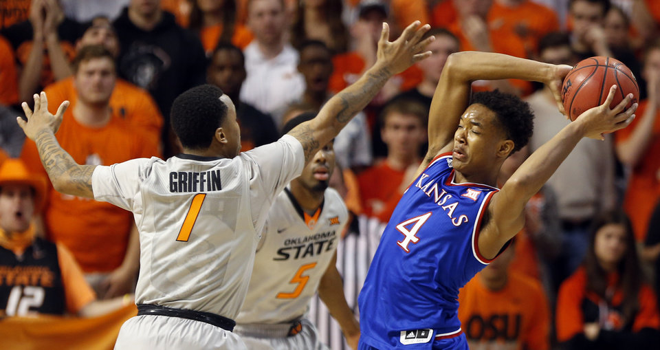 Photo - Oklahoma State's Tyree Griffin (1) and Tavarius Shine (5) defend against Kansas' Devonte Graham (4) during the men's college basketball game between Oklahoma State University and the University of Kansas at Gallagher-Iba Arena in Stillwater, Okla.,  Saturday, Feb. 7, 2015. OSU won 67-62. Photo by Sarah Phipps, The Oklahoman