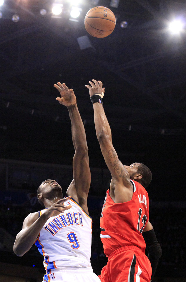 Oklahoma City's Serge Ibaka (9) grabs rebound from Portland's LaMarcus Aldridge (12) during the NBA basketball game between the Oklahoma City Thunder and the Portland Trail Blazers at the Chesapeake Energy Arena in Oklahoma City, Sunday, March, 24, 2013. Photo by Sarah Phipps, The Oklahoman