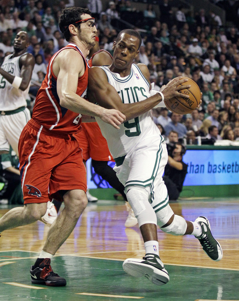 Photo -   Boston Celtics guard Rajon Rondo (9) drives to the basket against Atlanta Hawks guard Kirk Hinrich (6) during the first quarter of Game 3 of an NBA first-round playoff basketball series, Friday, May 4, 2012, in Boston. (AP Photo/Charles Krupa)
