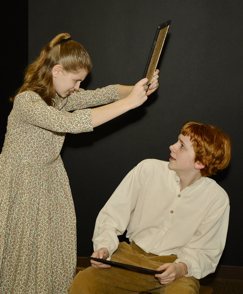 "Chelsea Yeager playing Anne Shirley, and Matthew Tripp playing Gilbert Blythe, rehearse a sceen from ""Anne of Green Gables."" PHOTO BY M. TIM BLAKE, for THE OKLAHOMAN. <strong>M. Tim Blake - FOR THE OKLAHOMAN</strong>"