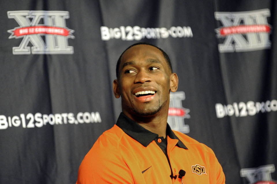 Oklahoma State running back Joseph Randle smiles during the Big 12 Conference NCAA college football media days, Tuesday, July 24, 2012, in Dallas. (AP Photo/Matt Strasen)