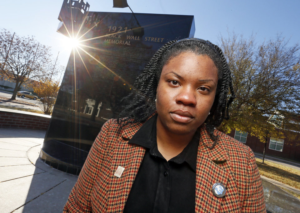 Photo - Shay White poses for a photo in front of the 1921 Black Wall Street Memorial located next to the Greenwood Cultural Center, 322 N Greenwood Ave., in Tulsa, Okla., Thursday, Dec. 8, 2016. Photo by Nate Billings, The Oklahoman