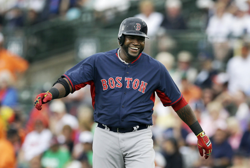 Photo - Boston Red Sox designated hitter David Ortiz walks back to the dugout after grounding out to end the first inning of a spring exhibition baseball game against the Baltimore Orioles in Sarasota, Fla., Monday, March 24, 2014. (AP Photo/Carlos Osorio)