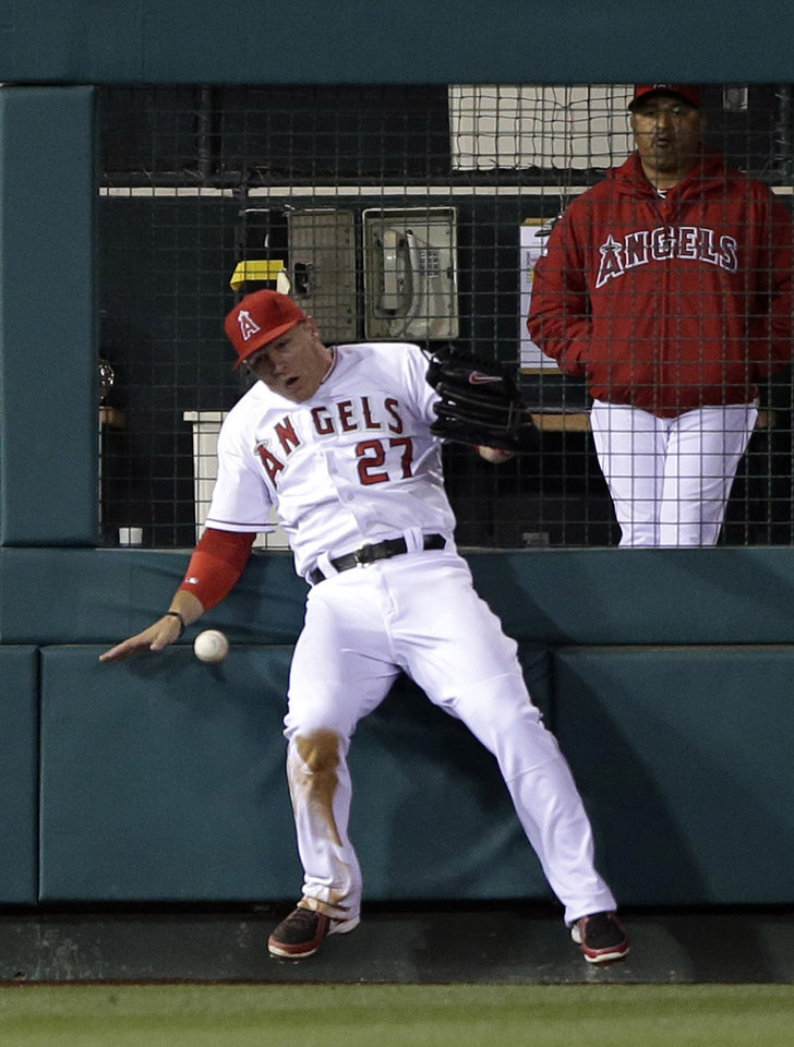 Los Angeles Angels left fielder Mike Trout misses a double hit by Texas Rangers' Mitch Moreland during the sixth inning of a baseball game in Anaheim, Calif., Monday, April 22, 2013. (AP Photo/Jae C. Hong)