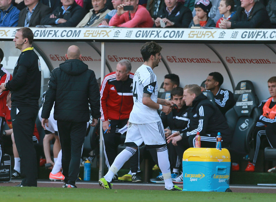 Photo - Swansea City's Chico, center right, leaves the pitch after being shown a red card during the English Premier League soccer match against Chelsea at the Liberty Stadium, Swansea, Wales, Sunday, April 13, 2014. (AP Photo/David Davies, PA Wire)     UNITED KINGDOM OUT   -    NO SALES   -    NO ARCHIVES