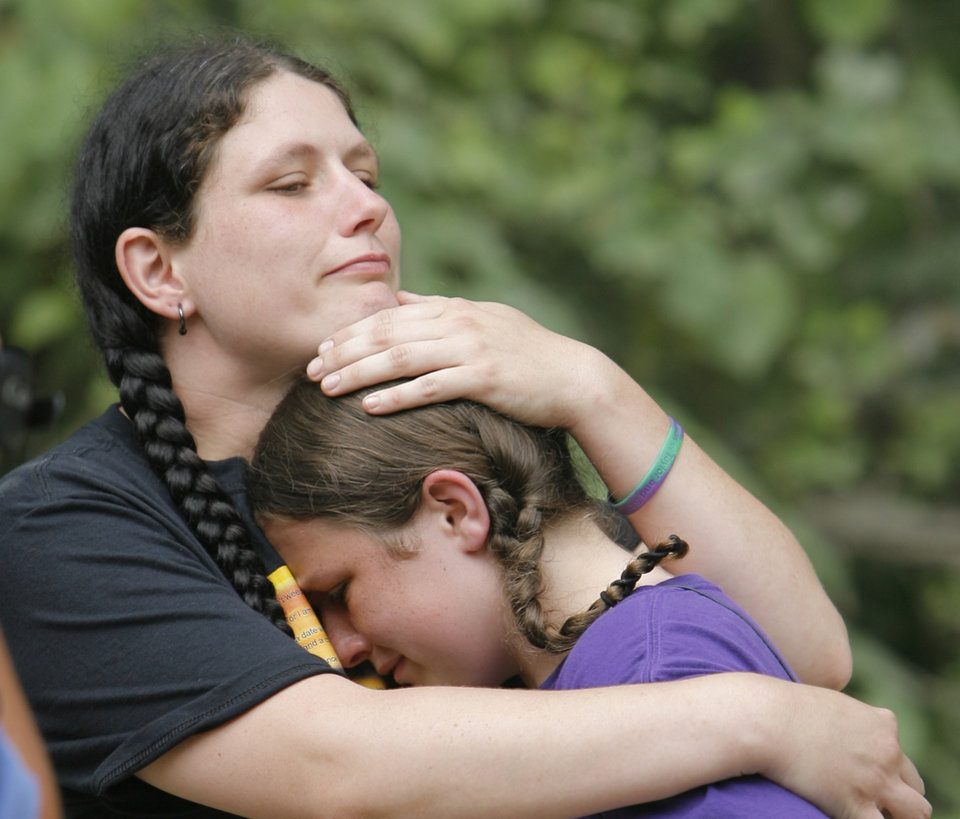 Tabitha Morgan comforts her daughter Stormie, 11, at the  the memorial site for Skyla Whitaker and Taylor Paschal-Placker near Weleetka, Okla. on Monday, June 8, 2009.  Law enforcement officials pleaded Monday for the public's help in helping to solve the double murder of Whitaker and Paschal-Placker on the anniversary of the shootings. The girls were found shot to death one year ago Monday along a dirt road in rural Okfuskee County. No arrests have been made in the case.  Photo by David McDaniel, The Oklahoman