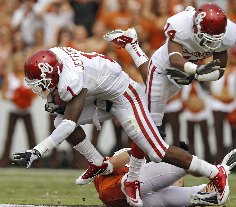 Photo - Oklahoma's Tony Jefferson (1) makes an interception during the Red River Rivalry college football game between the University of Oklahoma Sooners (OU) and the University of Texas Longhorns (UT) at the Cotton Bowl in Dallas, Saturday, Oct. 8, 2011. Photo by Chris Landsberger, The Oklahoman
