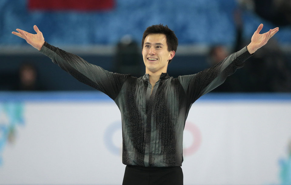 Photo - Patrick Chan of Canada acknowledges the crowd after completing his routine in the men's short program figure skating competition at the Iceberg Skating Palace during the 2014 Winter Olympics, Thursday, Feb. 13, 2014, in Sochi, Russia. (AP Photo/Ivan Sekretarev)