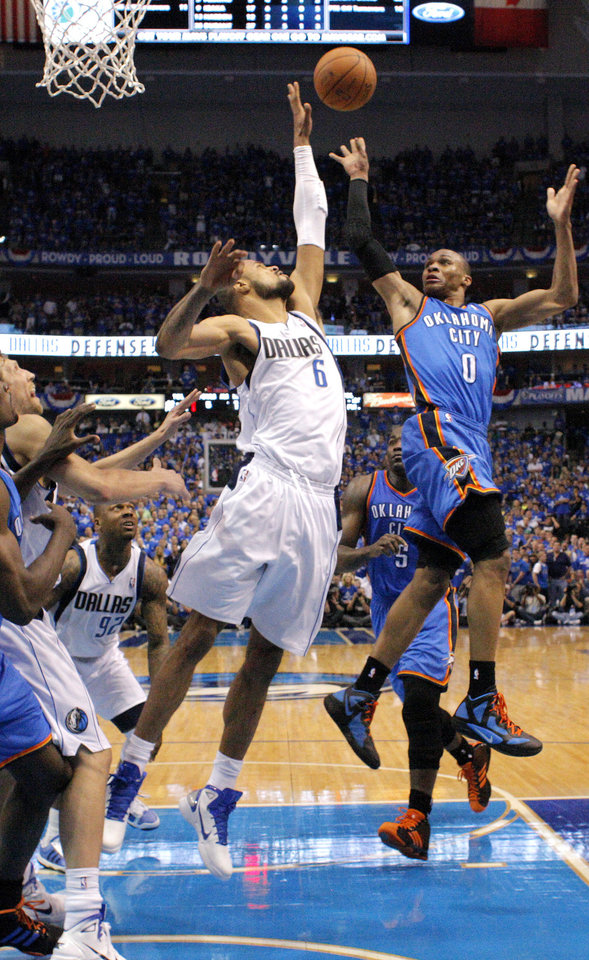 Oklahoma City's Russell Westbrook (0) tries to get past Tyson Chandler (6) of Dallas during game 1 of the Western Conference Finals in the NBA basketball playoffs between the Dallas Mavericks and the Oklahoma City Thunder at American Airlines Center in Dallas, Tuesday, May 17, 2011. Photo by Bryan Terry, The Oklahoman