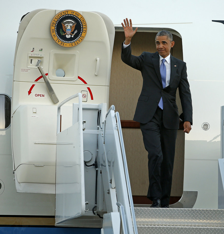 Photo - President Barack Obama waves o the crowd as he exits Air Force One at Tinker Air Force Base in Midwest City, Wednesday, July 15, 2015. President Barack Obama will visit the Federal Correctional Institution El Reno, where he will meet with Oklahoma law enforcement officials and inmates and conduct an interview for a documentary scheduled to air in the fall. Photo by Bryan Terry, The Oklahoman