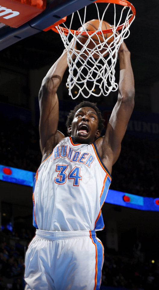 Oklahoma City's Hasheem Thabeet (34) dunks the ball during an NBA basketball game between the Oklahoma City Thunder and Charlotte Bobcats at Chesapeake Energy Arena in Oklahoma City, Monday, Nov. 26, 2012.  Photo by Nate Billings , The Oklahoman