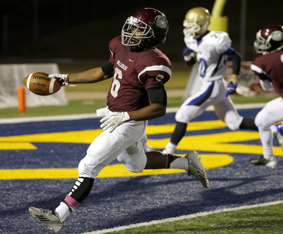 Edmond Memorial's Warren Wand scores a touchdown against Choctaw during their high school football game at Wantland Stadium in Edmond, Thursday, October 17, 2013. Photo by Bryan Terry, The Oklahoman