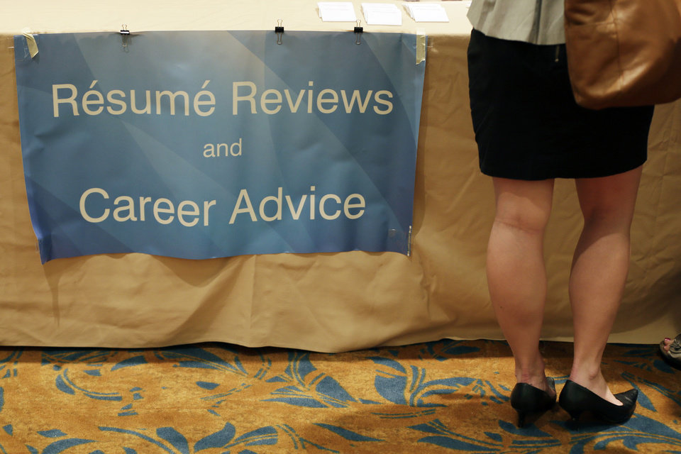 Photo - In this Monday, June 24, 2013, photo, a job seeker gets her resume critiqued at a career fair, in King of Prussia, Pa. U.S. employers added a robust 195,000 jobs in June and many more in April and May than previously thought. The job growth raises hopes for a stronger economy in the second half of 2013. (AP Photo/Matt Slocum)