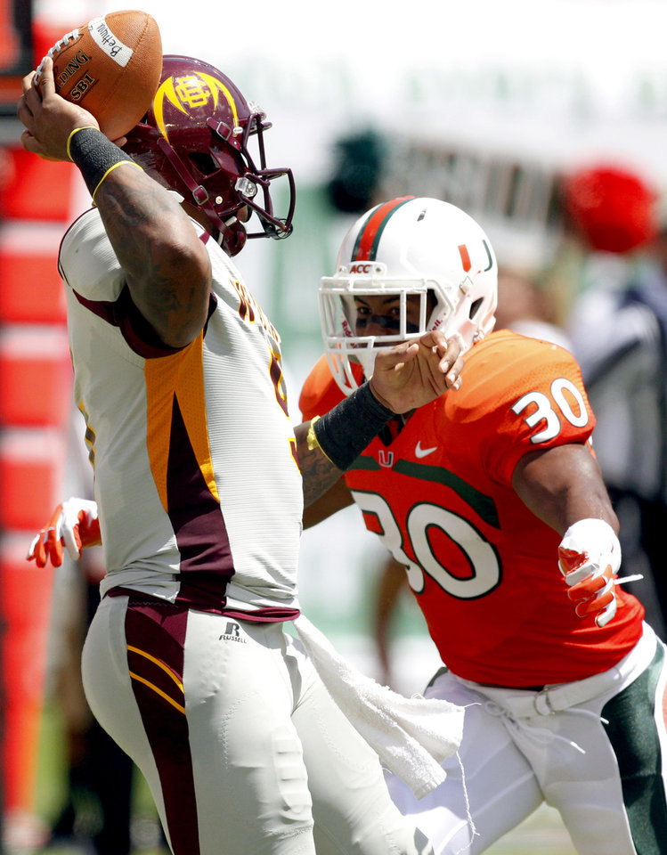 Photo -   Miami defensive back A.J. Highsmith (30) rushes Bethune-Cookman quarterback Jackie Wilson in the first half of an NCAA college football game, Saturday Sept. 15, 2012, in Miami. (AP Photo/Wilfredo Lee)