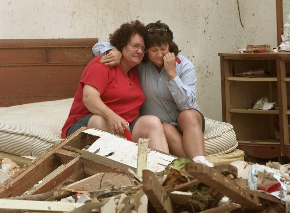 MAY 3, 1999 TORNADO: Tornado victims, damage: Delma Whitaker comforts her daughter Wanda Carpenter in the remains of her childhood bedroom. Whitaker's home was at 6000 SE 9th in Midwest City.