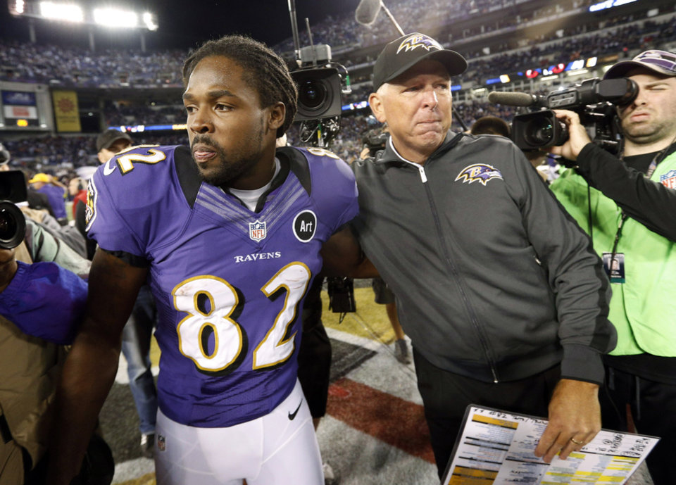 Photo -   Baltimore Ravens' Torrey Smith, left, embraces Ravens offensive coordinator Cam Cameron after an NFL football game against the New England Patriots in Baltimore, Sunday, Sept. 23, 2012. Baltimore won 31-30. (AP Photo/Patrick Semansky)
