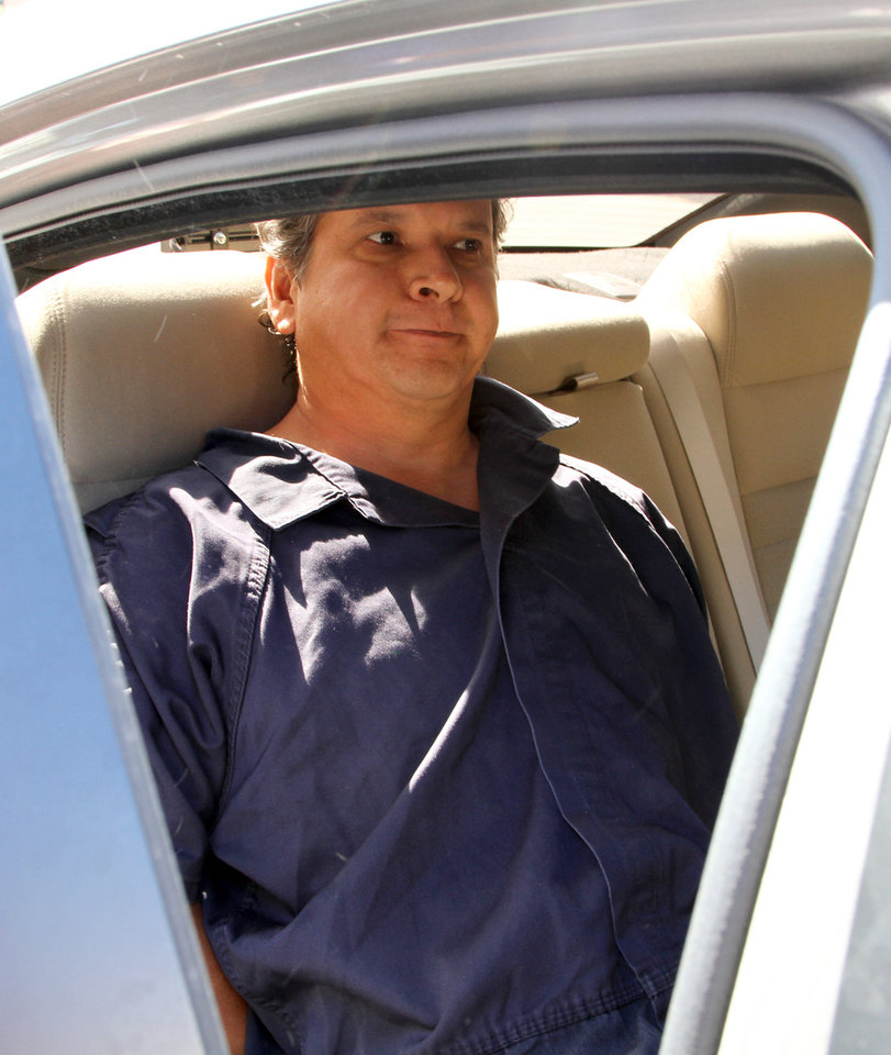 Photo -   Marco Antonio Delgado sits inside a car outside of the El Paso County Jail, Monday, Nov. 5, 2012 in El Paso, Texas. Delgado was arrested by Immigration and Customs Enforcement on charges of conspiracy to commit money laundering according to jail records. (AP Photo/Juan Carlos Llorca)