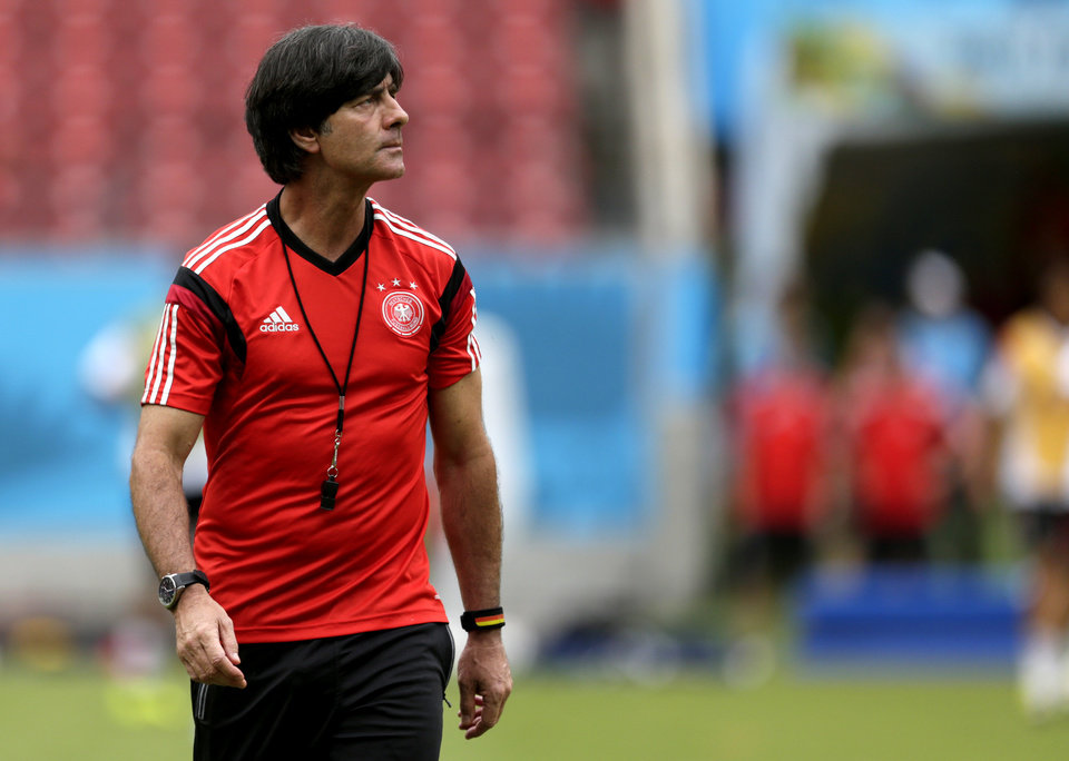 Photo - Germany's head coach Joachim Loew looks on during a training session in Recife, Brazil, Wednesday, June 25, 2014. Germany will play the United States in group G of the 2014 soccer World Cup on June 26. (AP Photo/Julio Cortez)