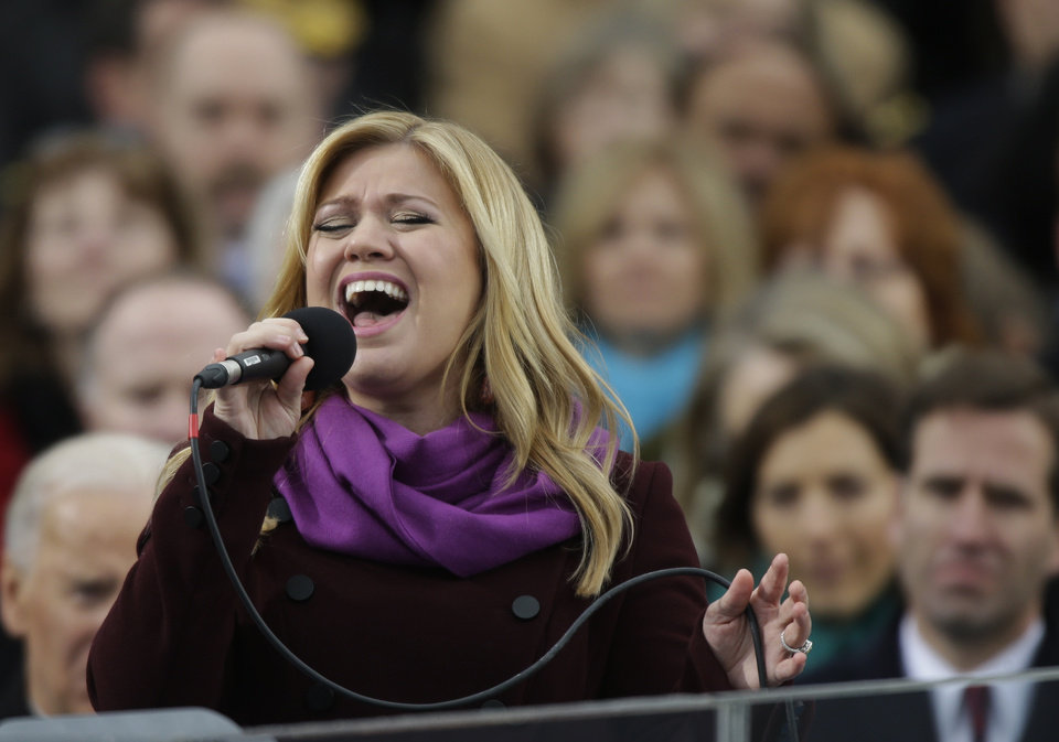 Photo - Singer Kelly Clarkson performs at the ceremonial swearing-in for President Barack Obama at the U.S. Capitol during the 57th Presidential Inauguration in Washington, Monday, Jan. 21, 2013. (AP Photo/Pablo Martinez Monsivais)