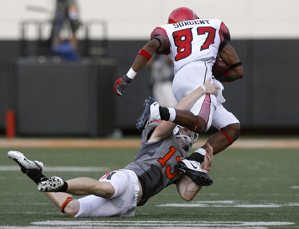 Photo - Oklahoma State's Quinn Sharp brings down Louisiana-Lafayette's Darryl Surgent during a long return Saturday night. Photo by Sarah Phipps, The Oklahoman