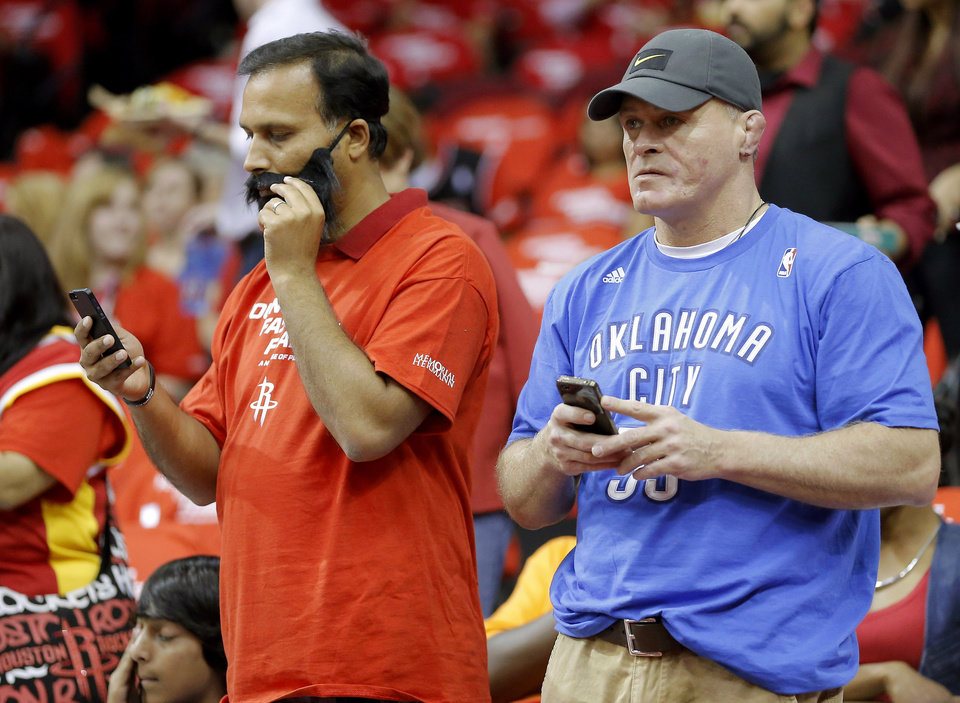 Brett Beams, originally from Shawnee but now a Houston resident, stands beside Houston fan Shak Muhammad as he adjusts his James Harden beard before Game 4 in the first round of the NBA playoffs between the Oklahoma City Thunder and the Houston Rockets at the Toyota Center in Houston, Texas,Sunday, April 29, 2013. Photo by Bryan Terry, The Oklahoman