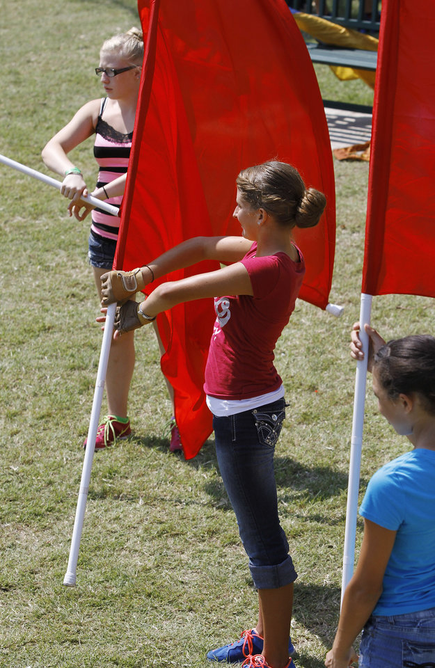Members of the Southmoore High School Color Guard practice techniques at a clinic hosted by the UCO Color Guard as part of Band Day activities  at the state fair on Monday, Sep. 17, 2012,  From left, Cherokee Robinson, Marissa Sultuska and Alyah Merritt. Photo by Jim Beckel, The Oklahoman.