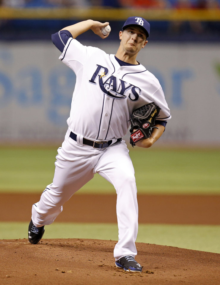Photo - Tampa Bay Rays starting pitcher Jake Odorizzi throws during the first inning of a baseball game against the St. Louis Cardinals, Tuesday, June 10, 2014, in St. Petersburg, Fla. (AP Photo/Mike Carlson)