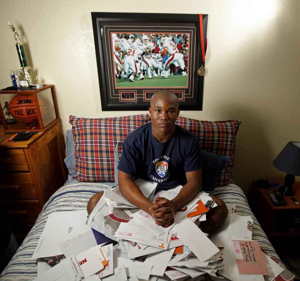 Photo - Heritage Hall's Barry Sanders sits in his room with recruitment letters in Oklahoma City, Saturday, Feb. 12, 2011.  Photo by Bryan Terry, The Oklahoman