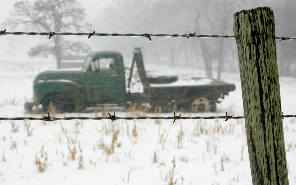 Photo - Ice covers a barbed wire fence on Charter Oak road in Logan County, Oklahoma December 24, 2009. Photo by Steve Gooch, The Oklahoman