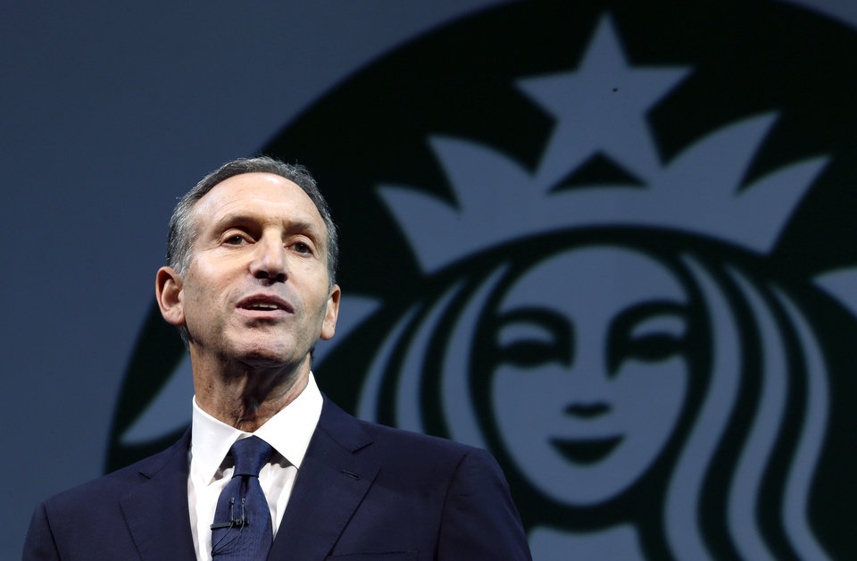 """Photo - FILE - In this March 20, 2013 file photo, Starbucks CEO Howard Schultz speaks at the company's annual shareholders meeting, in Seattle, Wash. Schultz is collaborating on a book about veterans of the wars in Iraq and Afghanistan. """"For Love of Country: What Our Veterans Can Teach Us About Citizenship, Heroism, and Sacrifice"""" will be published by Alfred A. Knopf on Nov. 4. The book will be co-written by Washington Post correspondent and editor Rajiv Chandrasekaran. According to Knopf, which announced the book Monday, a """"majority"""" of author proceeds will be donated to veteran services organizations. (AP Photo/Ted S. Warren, File)"""
