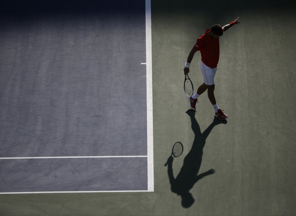 Photo - Novak Djokovic, of Serbia, reacts after a point against Marcel Granollers, of Spain, during the fourth round of the 2013 U.S. Open tennis tournament, Tuesday, Sept. 3, 2013, in New York. (AP Photo/Charles Krupa)
