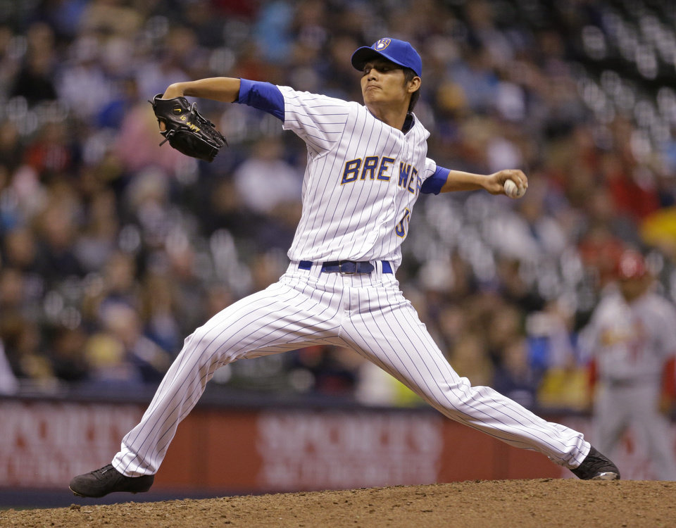 Photo - Milwaukee Brewer pitcher Wei-Chung Wang pitches to the St. Louis Cardinals during the ninth inning of MLB National League baseball game Monday, April 14, 2014, in Milwaukee. (AP Photo/Jeffrey Phelps)