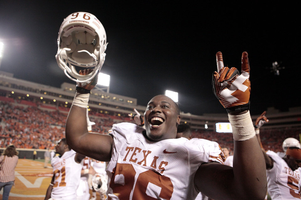 Photo - Texas' Chris Whaley (96) celebrates the Longhorns' win over Oklahoma State University (OSU) and the University of Texas (UT) at Boone Pickens Stadium in Stillwater, Okla., Saturday, Sept. 29, 2012. Texas on 41-36. Photo by Sarah Phipps, The Oklahoman