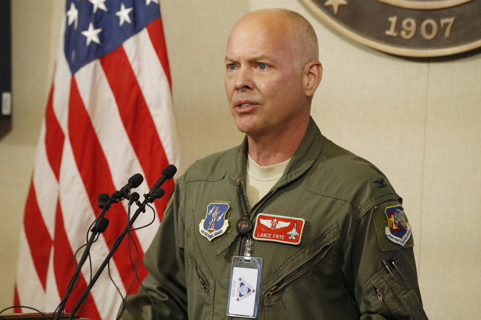 Photo - Dr. Lance Frye, State Air Surgeon, Oklahoma Air National Guard, speaks during a news conference Thursday, May 14, 2020, in Oklahoma City. The reopening of Oklahoma businesses will continue Friday, May 15, 2020, with stand-alone bars, funerals, weddings and organized sports activities resuming. (AP Photo/Sue Ogrocki)