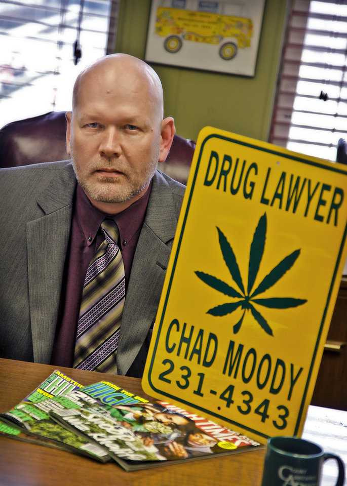 Drug lawyer Chad Moody poses for a photo with some of his promotional items at his office in downtown Oklahoma City on Wednesday, March 7, 2012 in Oklahoma City, Okla.  Photo by Chris Landsberger, The Oklahoman