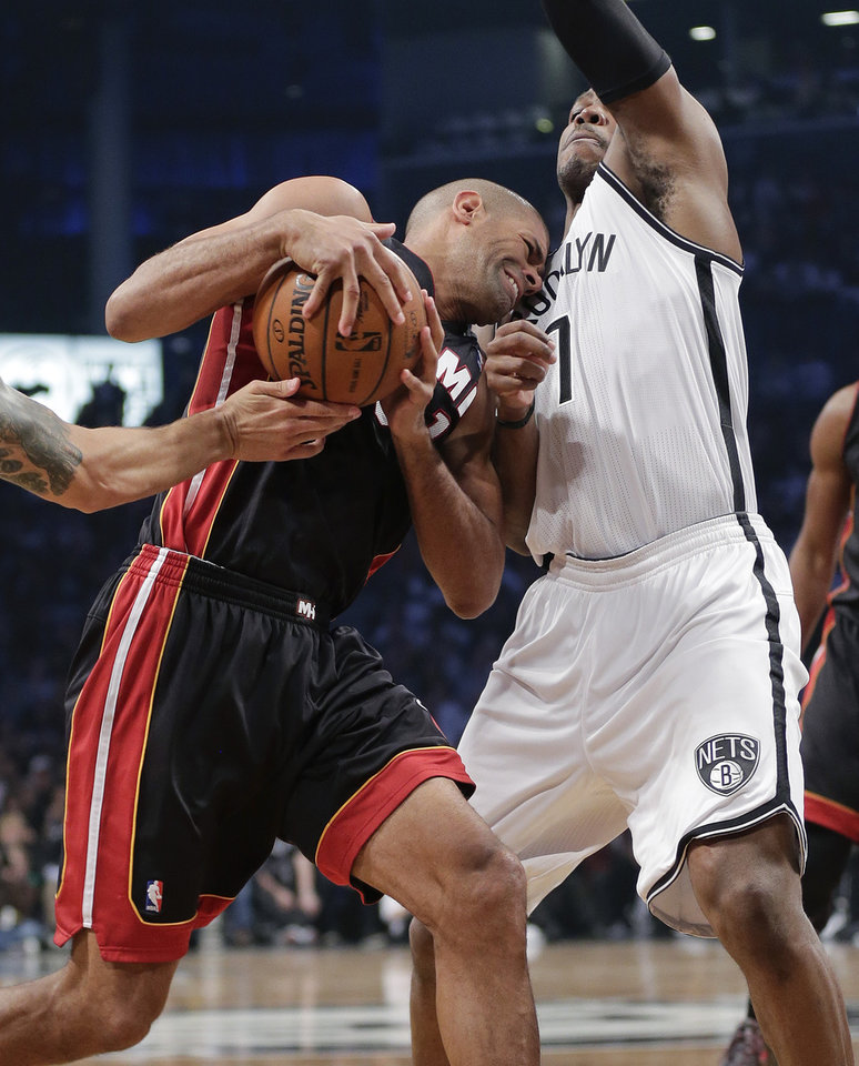Photo - Miami Heat forward Shane Battier drives against Brooklyn Nets forward Mason Plumlee (1) in the second period during Game 3 of an Eastern Conference semifinal NBA playoff basketball game on Saturday, May 10, 2014, in New York. (AP Photo/Julie Jacobson)