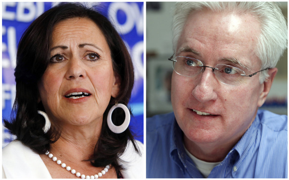 Photo - FILE - These photo combo of 2013 file photos shows state Sens. Angela Giron, D-Pueblo, and John Morse, D-Colorado Springs, who are facing recall elections, Tuesday, Sept. 10, 2013, in a battle that has attracted major players from around the nation, reflecting the sustained intensity over the issue of gun rights. (AP Photo/Ed Andrieski, File)