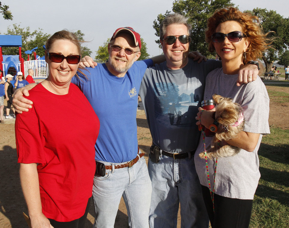 Photo - Michelle Statham (left), Chris Flanagan, James Allen, and Tracy Leeper and her dog