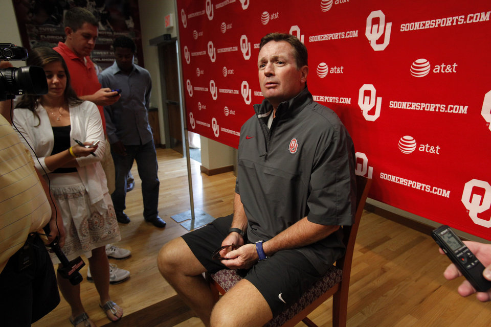 Photo - Head coach Bob Stoops speaks to the press at a media availability for the University of Oklahoma Sooner (OU) football team following practice on Tuesday, Aug. 21, 2012 in Norman, Okla.  Photo by Steve Sisney, The Oklahoman