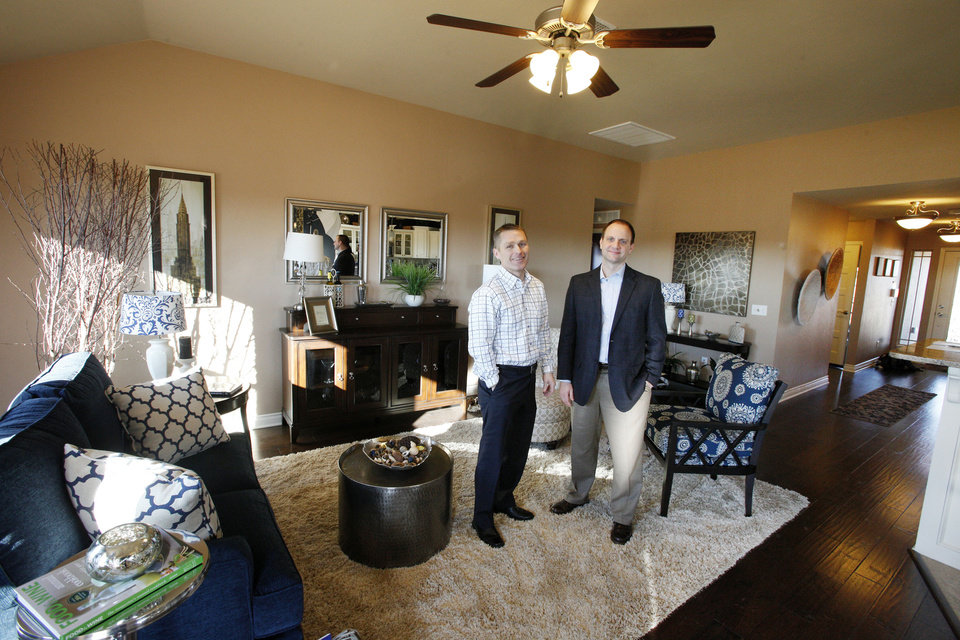 Photo - Vernon McKown, Ideal Homes owner and president of sales, and Steve Shoemaker, director of marketing, show the living room of an Ideal home at 11424 NW 131 in the Buffalo Grove area of the Village Verde addition in northwest Oklahoma City. Shoemaker says Ideal has increased the level of customization it provides buyers and that 2012 was the company's third best year ever. Photo by PAUL B. SOUTHERLAND, THE OKLAHOMAN