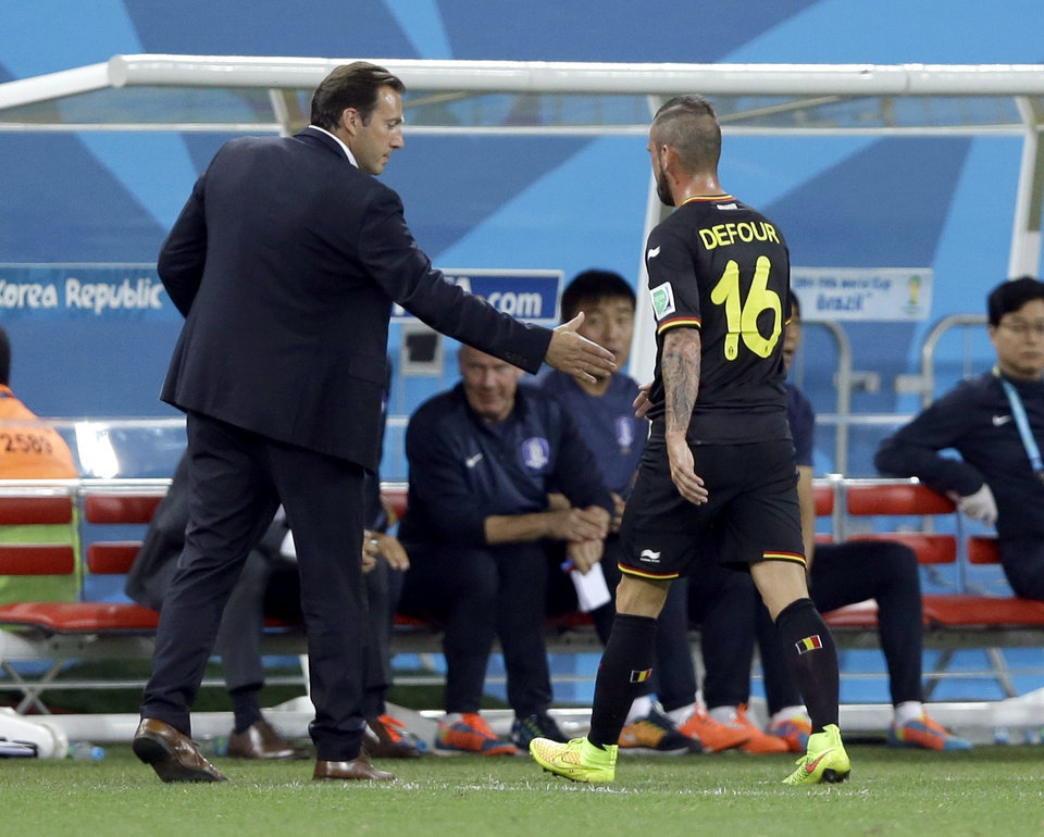 Photo - Belgium's head coach Marc Wilmots shakes hands with Belgium's Steven Defour after he was sent off on a red card during the group H World Cup soccer match between South Korea and Belgium at the Itaquerao Stadium in Sao Paulo, Brazil, Thursday, June 26, 2014. (AP Photo/Kirsty Wigglesworth)