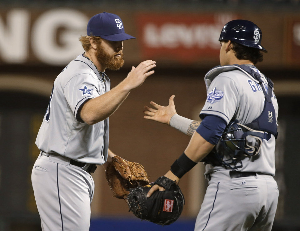 Photo - San Diego Padres relief pitcher Blaine Boyer, left, is greeted by catcher Yasmani Grandal at the end of a baseball game against the San Francisco Giants on Tuesday, June 24, 2014, in San Francisco. San Diego won 7-2. (AP Photo/Eric Risberg)