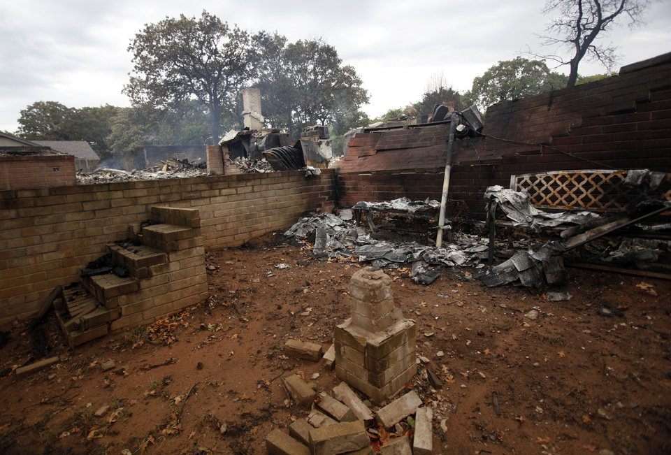 Joel Rodriguez's burned home Blackjack Lane is pictured in Edmond, Okla.,  Sunday, Aug. 7, 2011. Photo by Sarah Phipps, The Oklahoman
