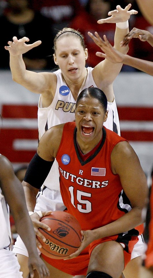 Photo - Purdue's Natasha Bogdanova puts pressure on Rutgers' Kia Vaughn during the NCAA women's basketball tournament game between Rutgers and Purdue at the Ford Center in Oklahoma City, Sunday, March 29, 2009.  PHOTO BY BRYAN TERRY, THE OKLAHOMAN