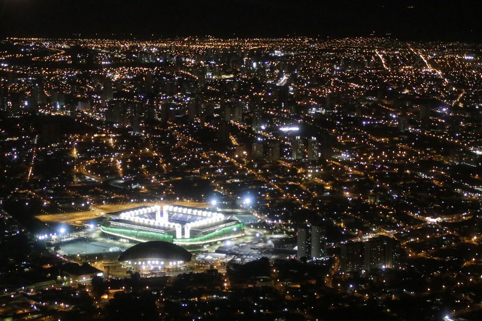 Photo - A night aerial view of the illuminated Arena Pantanal where Japan and Colombia met up for their group C World Cup soccer match, in Cuiaba, Brazil, Tuesday, June 24, 2014. Colombia defeated Japan 4-1, securing a top spot in Group C and eliminating the Asian champions. It was Colombia's third straight win and set up a second-round match against Uruguay. (AP Photo/Felipe Dana)
