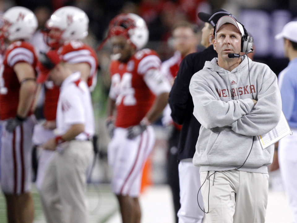 Nebraska coach Bo Pelini looks on from the sideline late in the fourth quarter during the Big 12 football championship game between the University of Oklahoma Sooners (OU) and the University of Nebraska Cornhuskers (NU) at Cowboys Stadium on Saturday, Dec. 4, 2010, in Arlington, Texas.  Photo by Chris Landsberger, The Oklahoman
