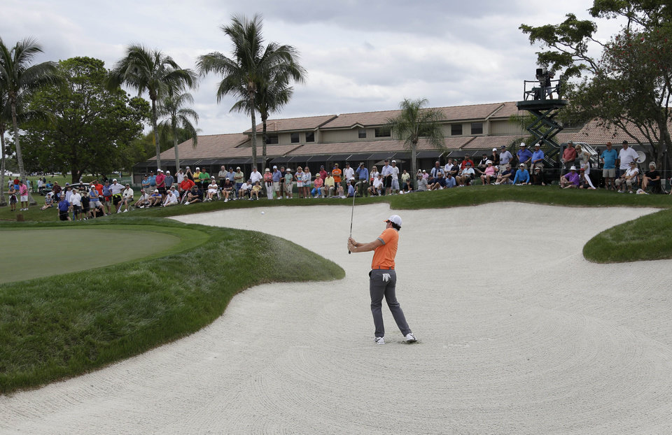 Photo - Rory McIlroy of Northern Ireland hits out of a bunker on the fifth hole during the first round of the Honda Classic golf tournament, Thursday, Feb. 27, 2014, in Palm Beach Gardens, Fla. (AP Photo/Lynne Sladky)
