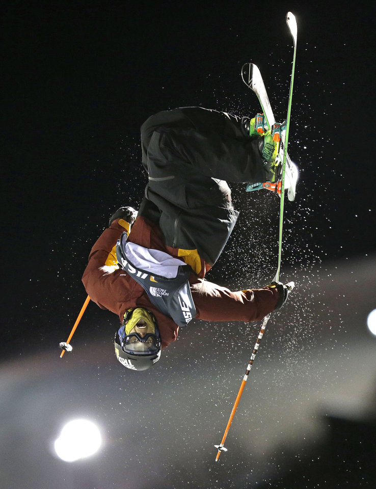 Photo - Lyman Currier, of the United States, competes during the men's U.S. Grand Prix freestyle halfpipe skiing event on Saturday, Jan. 18, 2014, in Park City, Utah. Currier came in first place. (AP Photo/Rick Bowmer)