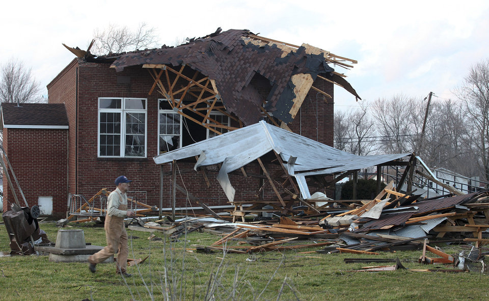 The Marysville Indiana Community Center sustained heavy damage after a  tornado passed through, Friday, March 2, 2012 in Marysville, Ind.  Powerful storms stretching from the Gulf Coast to the Great Lakes flattened buildings in several states, wrecked two Indiana towns and bred anxiety across a wide swath of the country in the second powerful tornado outbreak this week.  (AP Photo/The Courier-Journal, Sam Upshaw Jr.) NO SALES; MAGS OUT; NO ARCHIVE; MANDATORY CREDIT  ORG XMIT: KYLOC104