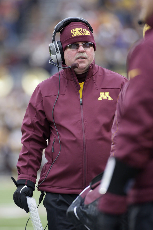 Photo -   Minnesota coach Jerry Kill walks the sideline during the first half of an NCAA football game against Michigan State, Saturday, Nov. 24, 2012, in Minneapolis. Kill suffered a seizure after the first half and did not return to the field. (AP Photo/Paul Battaglia)